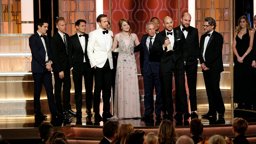 The cast and producers of La La Land accept the best musical comedy award Sunday at the Golden Globes NBC via reuters