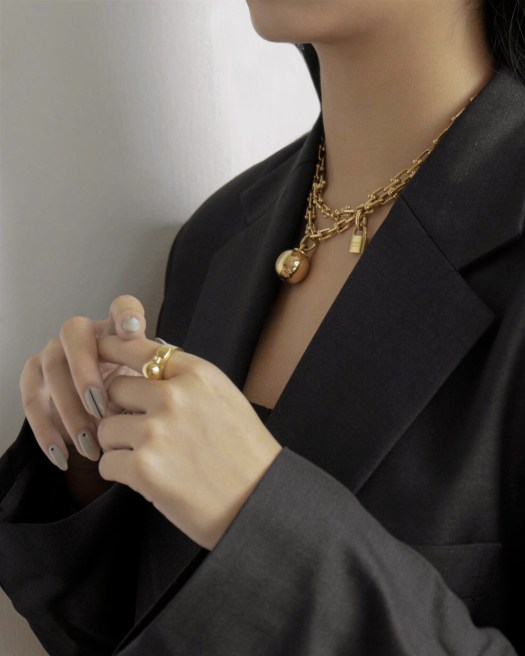 Tiffany HardWear Wrap Necklace in 18k Gold, $14,000 ; Tiffany HardWear Ball Dangle Ring in 18k Gold, $1,975
