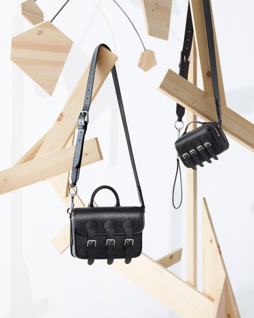 Left to right: Acne Messenger Matte Croc ($1,775) and Acne Mini Cross Body Satchel in black ($1,550)