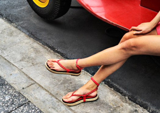 Sandals in Red Lambskin, $1,610. On nails: Le Vernis in 773 Chaîne d'Or, $41.