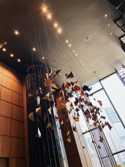 An art piece of 150 aluminium panels suspended from the ceiling, done by local artist Grace Tan.