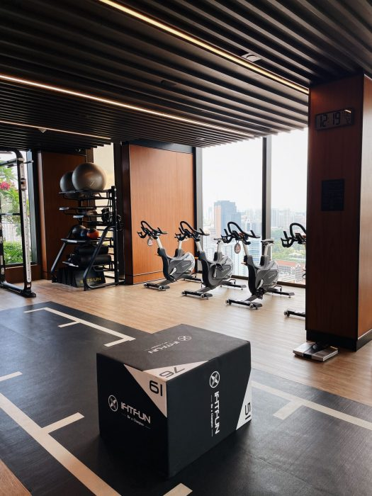 The gym is equipped with stationary bikes, mats, exercise balls and other equipment for various workouts.