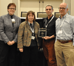 Joanna Laroussi and her team accepting the 2105 Applications Award on behalf of the NYC Department of Education for the PUTES application, a distance based transportation eligibility program for NYC students.