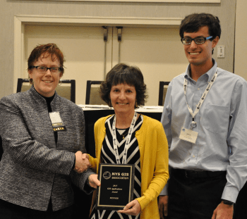 Linda Rockwood accepting the 2015 Applications Award on behalf of Mohawk Valley GIS for the NY Snowmobile Web Map and Trip Planner.