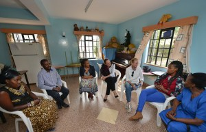 Naomi Watts, UNAIDS goodwill ambassador chats with Grace, a young woman who has grown up at Nyumbani Childrens Home in Nairobi, Kenya where Naomi visited in the company of her two sons, Sasha and Kai, to advocate for the sustainability of the HIV/AIDS response