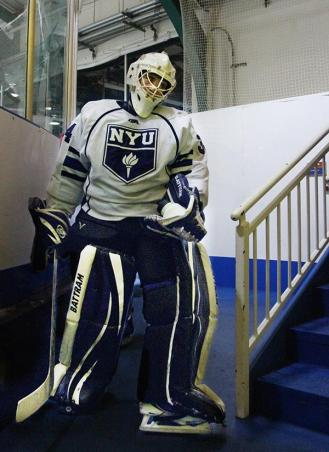 Goaltender Sam Daley walks to the locker room between periods.
