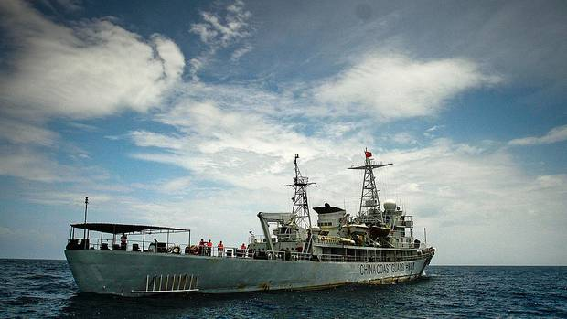 A Coast Guard vessel has rammed a Vietnamese fishing boat in the South China Sea, prompting fears Beijing is preparing to enforce its illegal claims to the territory. Photo / Getty Images