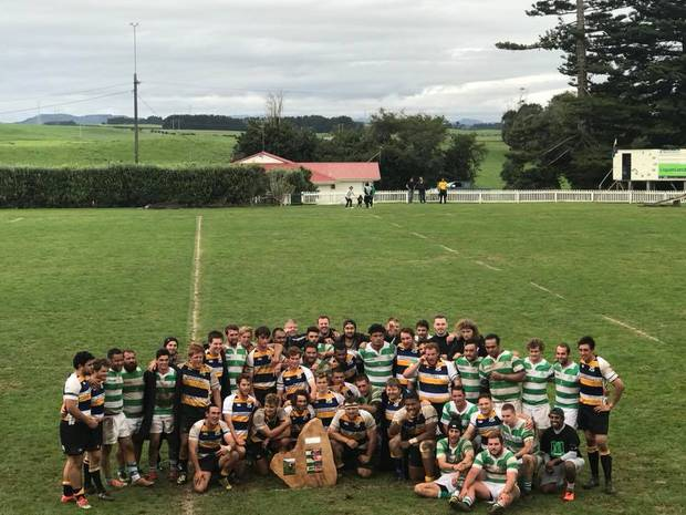 The Border and Marist players pose together with the Jake Alabaster Memorial Shield, with Border the first owners after the 45-22 win at Dallison Park on Saturday.