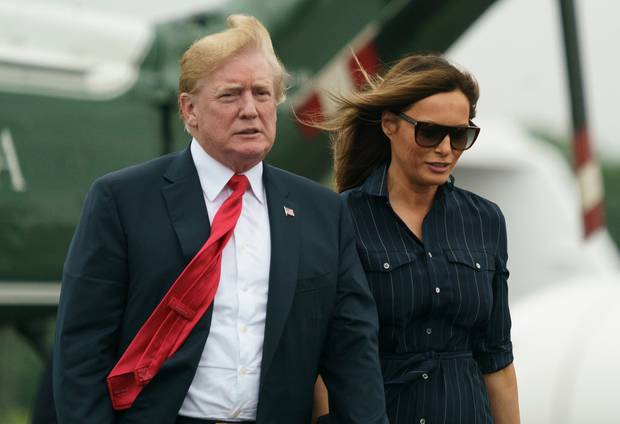 Mr Trump and first lady Melania walk from Marine One to board Air Force One on their way back to Washington. Photo / AP