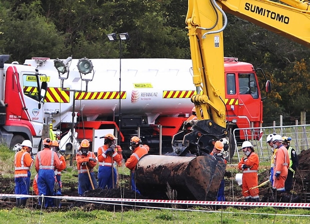 New Zealand Refinery staff at the site of a jet fuel pipeline leak on farm land between State Highway 1 and Marsden Pt Rd. Photo / John Stone