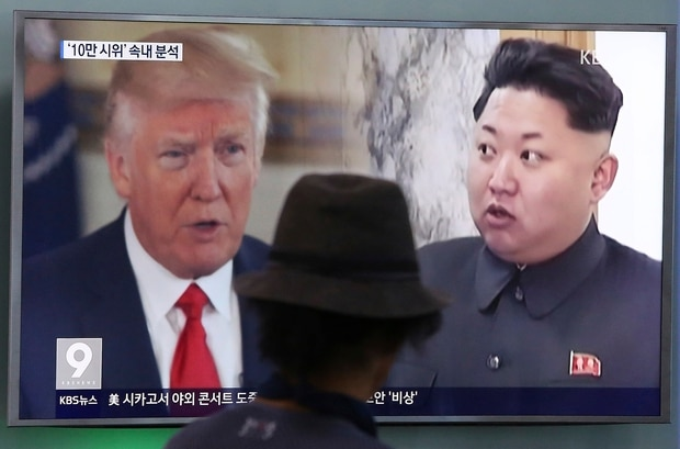 US President Donald Trump and North Korean leader Kim Jong Un during a news program at the Seoul Train Station. Photo / AP