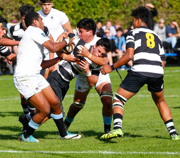 Collegiate's Phoenix Kairimu, seen here making a tackle against New Plymouth Boys High, was named school leaver of the year.