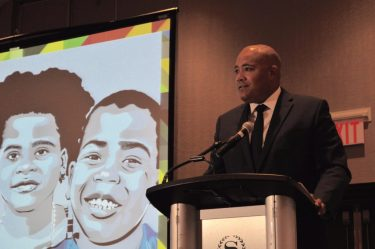 Minister Coteau addressing the Symposium attendees