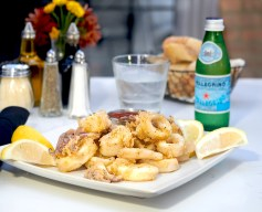 Guests can enjoy Jim and Pete's wild caught calamari with tangy cocktail on their sunny patio
