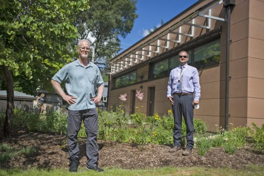 Architect Tom Bassett-Dilley, left, and Chris Lindgren, superintendent of parks and planning for the Park District of Oak Park, stand in front of the rain garden at the Carroll Center in Oak Park. | Alex Rogals/Staff Photographer