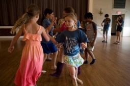 Ava Issel, right, partnered with Elizabeth Short for a horseshoe dance during the Oak Park Fiddle Camp.