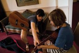 Strummin': Rachel Baiman helps Annie-Clare Wilson during guitar lessons.