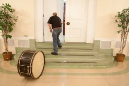 Drummer Albert Hasselman leaves his base drum to retrieve the other parts of his kit before a recent rehearsal at the Oak Park Arms.