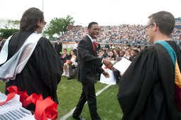 A happy graduate goes in for his diploma.
