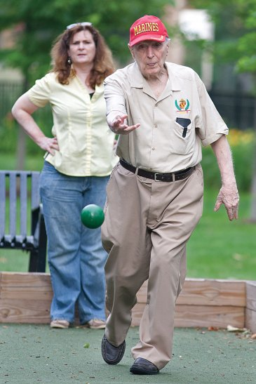 Hub Cheely is known for his steady hand on the bocce ball courts in River Forest. At 90, he is a newcomer to the sport, which also attracts players as young as 12 in league play every Tuesday night in a park on Lake Street.