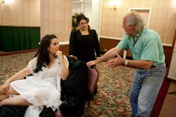 Stage director William Powers goes over placement with Nicole Cooper, who plays Violetta's servant who tends to her during the death scene. (David Pierini/staff photographer)