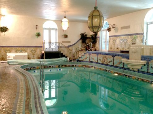 Natatorium: The pool with its organic shape is finished in a Gaudiest riot of tiles. (Photo by Garret Eakin)