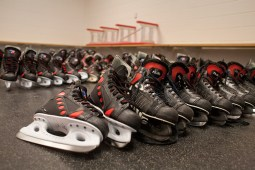 Rental skates are lined up and waiting to placed in their new hutches. (David Pierini/staff photographer)