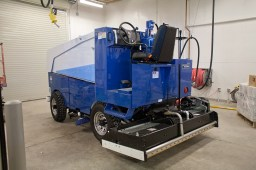 A new electric Zamboni machine will eliminate fumes and resurface the ice up to 14 times on a single charge. (David Pierini/staff photographer)