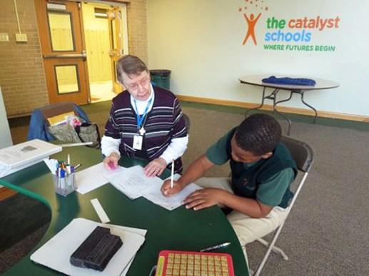 Sr. Helen Strueder tutors scholars at Catalyst School. (Courtesy Lynne and Bill Higgins)