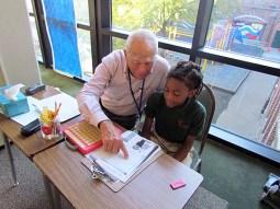 Dr. Bill Baker tutors scholars at Catalyst School. (Courtesy Lynne and Bill Higgins)