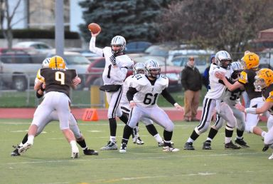 Jack Beneventi throws a pass during the Friars' 31-14 win over host Carmel on Saturday in the Class 7A playoffs. (Photo by Jim Krecek)