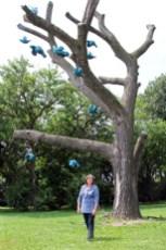 """Artist McMahon with her """"Flock"""" sculpture in Jackson Park. Courtesy the Oak Park Art League."""