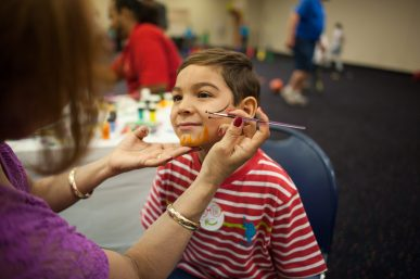 Nicholas Ellis, gets his face painted at the YMCA's Healthy Kids Day event at Living Word Christian Center in Forest Park. WILLIAM CAMARGO/Staff Photographer
