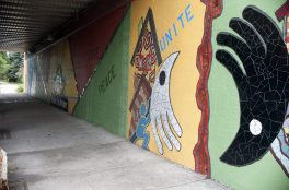 The latest Off the Wall summer art project adorns the Austin viaduct near Lake Street. A team of student artists created the mural. | WILLIAM CAMARGO/Staff Photographer