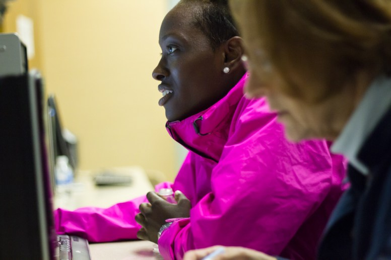 Bria Dyer works on her homework with Joni Strand at a tutoring session at Cluster Tutoring. | STACEY RUPOLO/Contributor