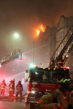 The Oak Park Fire Department responds to a fire on Washington and Cuyler on Tuesday, Oct. 21, 2015. The fire started around 9:30 p.m. and continued into early Wednesday morning.| BRENDAN DONLEY/Contributor