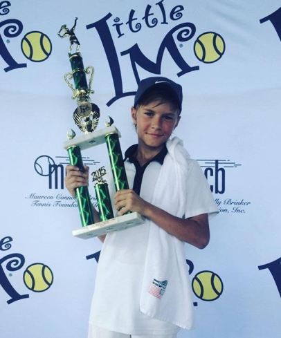 "Gabrielius Guzauskas, of Downers Grove, won the Boys 12 Singles title at the ""Little Mo"" Internationals in December of 2015. He now attends the world renowned Sanchez-Casal Academy in Naples, Fla. (Courtesy Luka Bagos)"