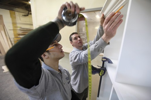 Sizing up space: Craig Sellers (right) works with one of his employees, Rod Engleberg, at his shop, For Your Space Design, in Chicago. Sellers custom designs and builds cabinets for homes. Much of his business derives from Oak Park and River Forest.Photos by J. GEIL/Staff Photographer
