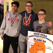 OPRF individual state medalists (left to right) Eddie Bolivar, Joe Chapman and 106-pound state champ Jake Rundell led the Huskies to a 60-7 victory over Maine South in the Sweet 16 round of the IHSA dual team state tournament. (Photo by Jamil Smart)