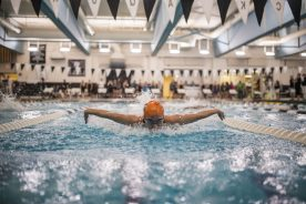 OPRF senior Nell Behr swims in the second heat of the 100-yard butterfly at the Fenwick Sectional on Saturday, Nov. 10 (Alexa Rogals/Staff Photographer)