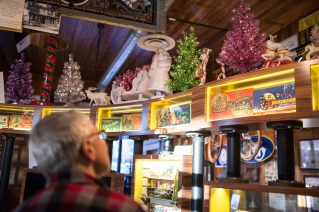 Jerry Ehrenberger looks up at his holiday decorations displayed above the cases on Nov. 14, at the Oak Park River Forest Museum on Lake Street in Oak Park. | Alexa Rogals/Staff Photographer