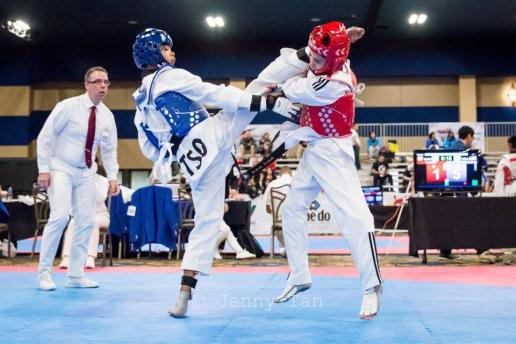 Flying V student Chandler Torres, left, won a gold medal in sparring at the 2019 USA Taekwondo Nationals in Minneapolis. He's also on Team USA. (Courtesy Jenny Tan Photography)