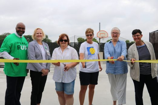 (L to R) Nathaniel Powell, Rush Oak Park Hospital; Lynne Casey, Rush Oak Park Hospital; Kassie Porreca, Park Board Commissioner; Karen McMillin, pickleball organizer; Sandy Lentz, Park Board President; Jan Arnold, Park District Executive Director at the ribbon cutting for pickleball courts at Barrie Park (COurtesy Park District of Oak Park)