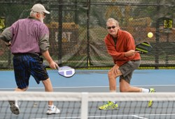 Oak Parkers Bob Lempera, left, and Greg Spear play doubles in pickleball. (Alexa Rogals/Staff Photographer)