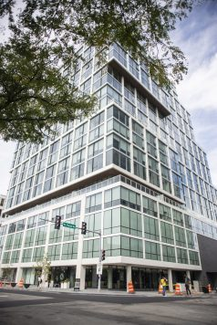 So big: The Albion (above) at 1000 Lake St. in downtown Oak Park was among the high-rises - and the latest -- completed in 2019. The 19-story structure includes 265 rental units and offers such amenities as a pool, dog run, indoor/outdoor yoga stations and a coffee bar. | File photo