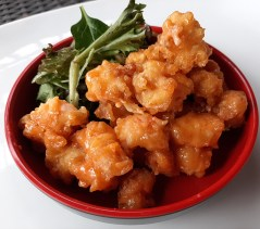 The rock shrimp appetizer from Inari features tempura fried shrimp with a sweet and spicy glaze.