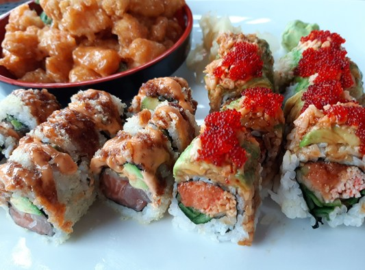 The S.T.A.Y Rolling roll (left) and the X'mas roll are among the many colorful specialty maki offerings at Inari Sushi.