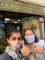 Shivangi Khetarpal, co-owner of Wise Cup, give a thumbs up alongside Susie Goldschmidt of Byline Bank.