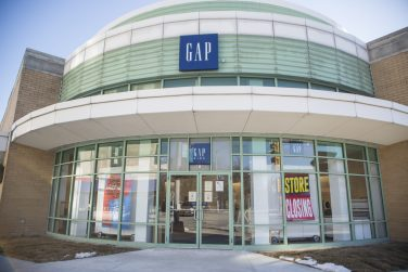 "The Gap storefront is pictured on Jan. 22, 2021 with a ""store closing"" sign at the Harlem Avenue and Lake Street location in Oak Park, Ill. 