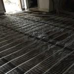 Fitting Under floor heating limecrete flooring in St Buryan Cornwall